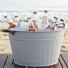 Giant barrels filled with bottle beer or wine coolers would be great and cheap wedding bar alternative