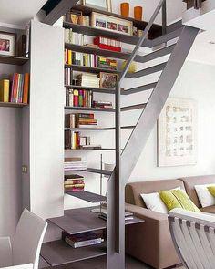 Essa eu gostei e muito... escada estante! Ótimo recurso pra aproveitar espaços e decorar o ambiente. O design da escada vazada deixa a estante leve e iluminada, com bastante destaque.  Imagem via decora.me