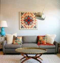 bright and fun colors offset by the gray couch! I think I need a gray couch...