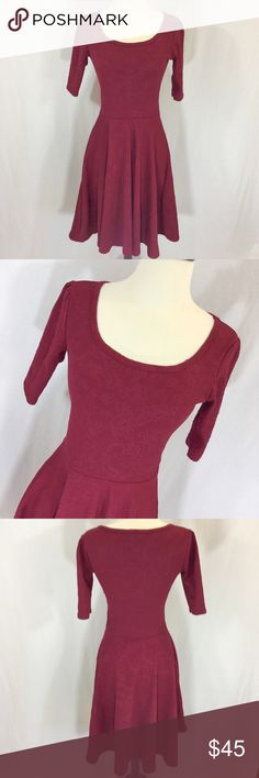 LuLaRoe Nicole burgundy floral embossed dress Excellent used condition LuLaRoe Nicole dress in burgundy with embossed floral design size XS. 38 1/2 inches long 16 inches armpit to armpit and 26 inch waist LuLaRoe Dresses