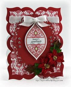 Kathy Jones designed this stunning red and white Christmas Card using Holiday Cheer Ornaments  (die cut with Spellbinders 2012 Heirloom Ornament Die) and our Embroidered Background Stamp embossed in white and the Petaloo Velvet Mini Poinsettia flowers. Kathy created her card base and layers with Spellbinders Grand Labels Twenty Three and Spellbinders Floral Ovals.