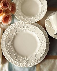 This white china is so pretty. I love the varied patterns. This is the style I have for my table.