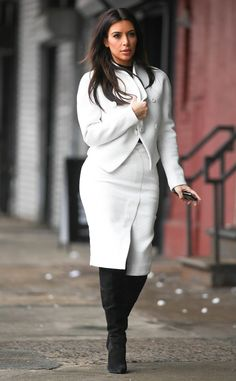 Kim Kardashian's super chic in a curve-hugging winter-white skirt and jacket suit.