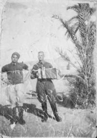 Giuseppe Torcasio seen here playing a diatonic button accordion which he used to entertain the troops.WW2 North Africa
