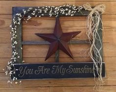 This prim wooden window is handmade in our workshop! It measures 20 x 16 and is decorated with prim berry garland, raffia, large metal star Diy Rustic Decor, Prim Decor, Rustic Crafts, Country Crafts, Handmade Home Decor, Country Decor, Farmhouse Decor, Window Frame Crafts, Window Art