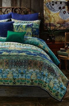 Adore the mix of green and blue on the quilt and shams.