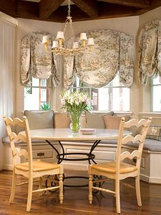 Planning on turning my dining room into a banquette with window seating kinda like this one.  Better colors though :)
