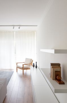 View the full picture gallery of Carnide Apartment Neutral Walls, Minimalist Apartment, Drawer Unit, Mid Century Chair, Double Doors, Custom Furniture, Floating Shelves, Minimalism, Kitchen