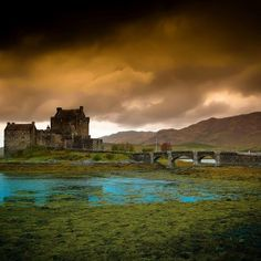 Eilean Donan Castle in Kyle of Lochalsh, Scotland  Photo~ Peter Young. On the mainland en route to Skye