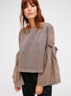 So Obvious Top | Ultimate cool girl top with a super chic feel. Features dramatic flared sleeves and a gorgeous open back with adjustable ties at both details.