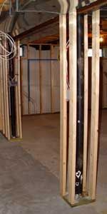 How to frame basement poles: To help when framing basement support poles, use quick clamps to hold the bottom plates in place while you secure them