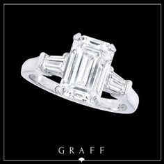 2.62ct Emerald Cut Diamond with Tapered Baguette Diamond Shoulders.