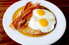 http://www.refinery29.com/46764#slide1  Piled up with Heritage Acres bacon, farm fresh eggs, and a ricotta pancake drizzled with Vermont maple syrup, it's a plate full of ...