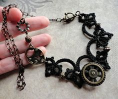 Tatted asymmetrical necklace black and brass, steampunk