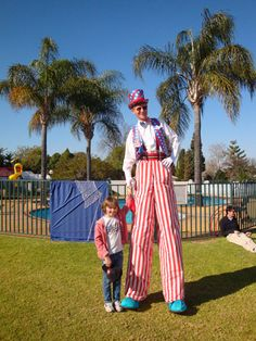 stilt walking, images - Google Search