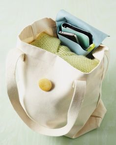 Tote topper pocket. With a swatch of Ultrasuede fabric, a button, and a few quick stitches, you're good to go.
