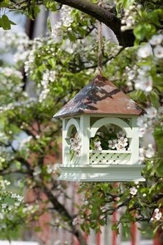 Charming Birdhouses/Feeders in the Garden | from Ana Rosa                                                                                                                                                      More