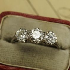 The three stone engagement ring is a sweetly symbolic alternative to the…
