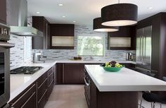 Kitchen with dark cabinets and white quartz counters AND MARBLE ...