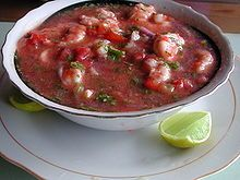 nation dish of ECUADOR is Ecuadorian ceviche, made with shrimp, lemon and tomato sauce