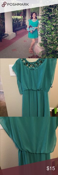 Beautiful green dress from Francesca's Green dress, size small, criss cross detailing, worn a few times, in good condition: Francesca's Collections Dresses