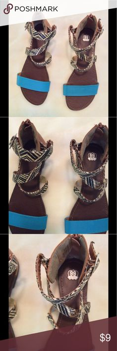 🆕 Route 66 Crisscross strapped flat sandals 7 1/2 Brown sandals with blue strap and Black and Tan crisscross strap. Zipper at heel. Flat sandals.  Size:  7 1/2 M   Brand:  Route 66    Listing:  319 Route 66 Shoes Sandals