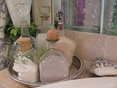 Liquor bottles: decant bubble bath, bath salts into pretty tequila or other liquor bottles . No more ugly plastic containers.