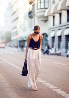 Paris Street Style - White wide leg trousers with a silk black cami and strappy sandals. This is Parisian Style.