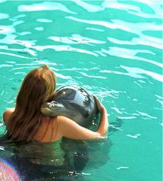 .Swimming with the dolphins in Nassau - they are so smart !