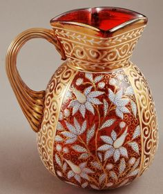 Richly gilt and enamelled vintage cranberry glass pitcher by Moser