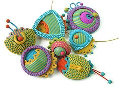 ajates_brooches by cynthia tinapple, via Flickr; Polymer Clay Daily
