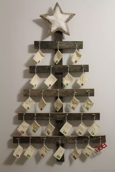This would be cute to roll up little messages or verses inside...or scavenger hunt mayb...Rustic Advent Calendar. Wall Mounted Advent Calendar perfect for a Rustic Christmas.