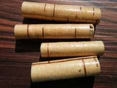 Four light brown birch bark wood beads, tube shaped, 39 and 50mm lengths, $12.00
