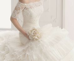 Wedding dress, love the tight bodice w/ ruffly skirt