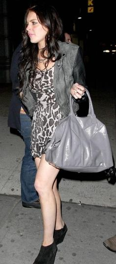 Who made Lindsay Lohan's black wedge shoes and gray purse that she wore in New York, April 12, 2010?
