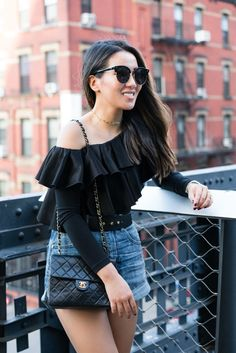 High-waisted denim shorts to create a longer frame, paired with an off the shoulder ruffle top. Summer classics!
