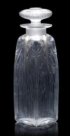 René Lalique 'Quatre Cigales' a Perfume Bottle and Stopper, design 1910 frosted and polished glass 13.5cm high, etched 'R. Lalique France no. 475'
