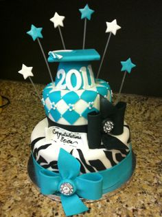 Black and Teal Zebra Print  Graduation Cake - Funky zebra print with matching school colors for the graduation girl!  Bows with the button gemstones were inspired by My Favorite Cake Place!