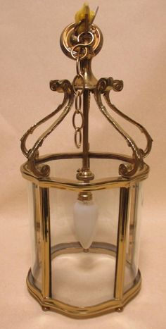 Sale D051115 Lot 660A  An 18th century style brass framed hall lantern, with hanging chains and mount  - Cheffins