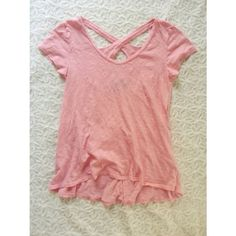 {anthropologie} pink cutout tee Super cute neon pink tee shirt from Anthropologie. Brand is 'left of center'.  Size XS. Interesting cutout on the back. Loose fitting and flattering. Pair with jean shorts! Gently worn. Anthropologie Tops Tees - Short Sleeve