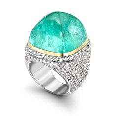 Featuring an extremely rare colour of tourmaline, Theo Fennell's;Mozambique; ring is set in white gold. The ring also has 4.87ct of diamonds alongside the 61.94ct African Paraiba tourmaline.