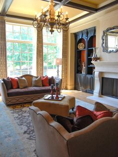 Twin camelback sofas are arranged for cozy conversation in this formal yet comfortable living room. Dark wood molding and trim accentuates the height of the room while maintaining an intimate feel.
