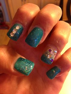 Mom's work teal/blue tip nails with blue glitter and silver, purple rhinestones