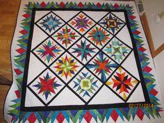 Made from many blocks from Carol Doak's book, Mariner's Compass Stars
