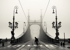 """On a foggy day"" by torobala.deviantart.com on @deviantART  #foggy #day #fog #budapest #liberty #bridge #hungary #bw #black #white #bicycle #man #magic #place"