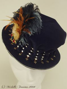 The Mistress Vavasour--Navy velvet, freshwater pearls, brooch, swarovski crystals, seed beads, gold thread, gold trim, ostrich feathers. Created by Michelle Fennema 2008.