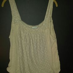 I bought it to get 15% my purchase It's super comfy and cute with shorts or a skirt. Wear a a bandeau under it and its a really cute outfit. I wore it a couple times but my chest is too big to just wear a bandeau under it. American Eagle Outfitters Tops Tank Tops