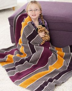 Bold stripes of rich color make this lapghan a stylish home decor piece. Free pattern knit in Bernat Satin.