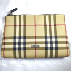 Burberry Nova Check Clutch %100 authentic. Classic Burberry Nova check purse with PVC exterior, leather trim, zip closure and black lined interior. Gently used. It's great as clutch or cosmetic bag. Very clean, no smell, rips or stains. Trade at $200 Burberry Bags Clutches & Wristlets