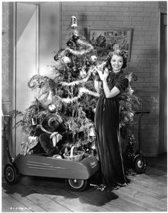 Vintage publicity shot of Janet Gaynor by a Christmas tree. Old Time Christmas, Ghost Of Christmas Past, Old Fashioned Christmas, Victorian Christmas, Christmas Holidays, Christmas History, Holiday Tree, Christmas Morning, Christmas Cards